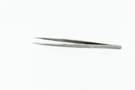 implementing: metal tweezers tools isolate on white background