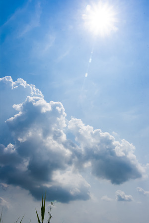 above clouds: Sun shine above the white clouds in blue sky Stock Photo