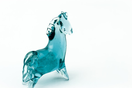 blown: Horse blown glass translucent blue on a white background