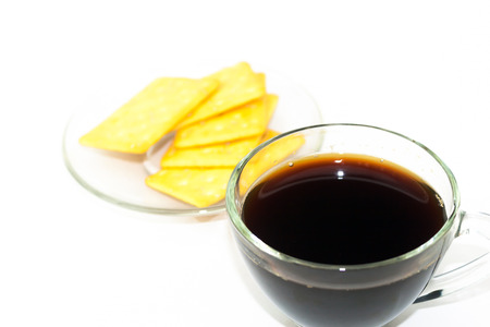 sesame cracker: Black coffee in transparent glass with sesame square cracker isolate Stock Photo