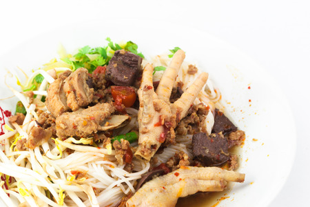 thai noodle: Khanom Jin Nam Ngiao with chicken leg, pork ribs, blood, bean sprouts
