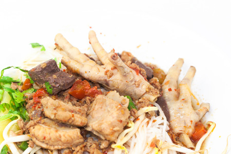 Khanom Jin Nam Ngiao with chicken leg, pork ribs, blood, bean sprouts photo