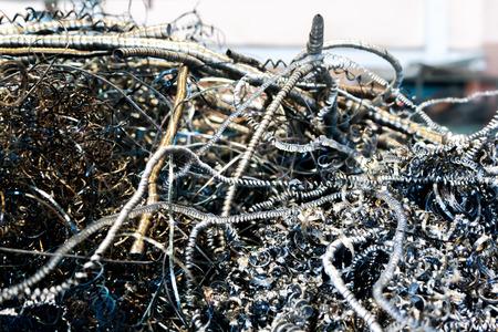 metal scrap: large pile of waste metal scrap in the big steel tank