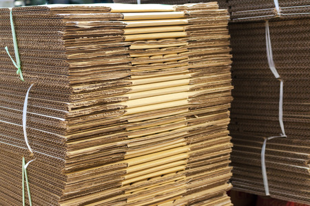 flattened: Stacked brown corrugated cardboard boxes flattened boxes Stock Photo