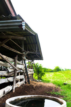 outbuilding: Old gray wooden animal Rearing house in up-country