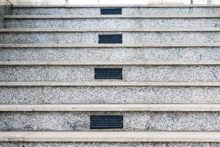 vents: Gray marble staircase a marble staircase in the center air vents.