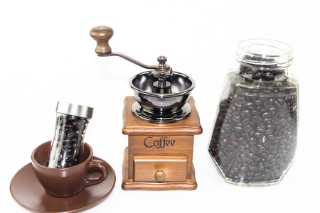 coffee blender: coffee blender spinner with coffee bean in glass jar and coffee bean bottle in ceremic cup