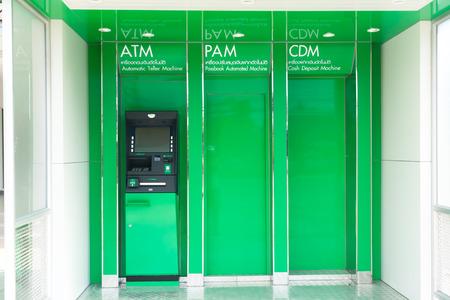 automatic teller machine: Black automatic teller machine on reflex light green slot plate