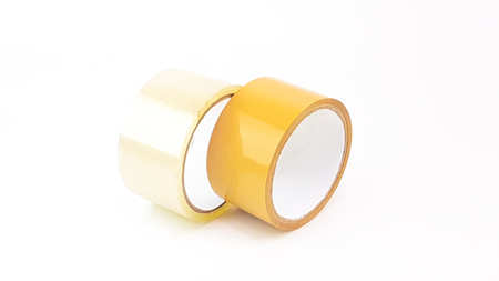 Thick transparent plastic tape and brown plastic tape in white big core isolated Stock Photo