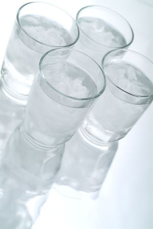 4 Glasses of Ice water on a reflective surface, vertical , high key Stock Photo - 2037813