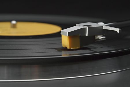 Horizontal close up of headshell and stylus on a turntable Stock Photo