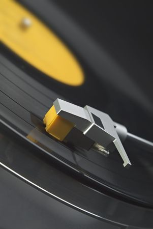 Tilted close up of headshell and stylus on a turntable