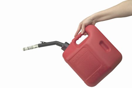 gas can: Womens hand pouring moeny from a gas can. Isolated on white Stock Photo