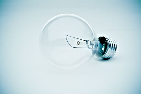 contrasty lightbulb in a subtle electric blue hue Stock Photo