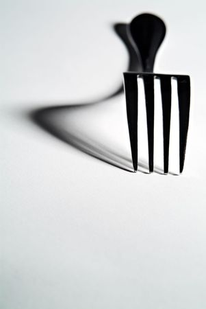 high contrast: High contrast close-up of a fork with defined shadows