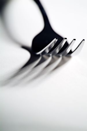 High contrast close-up of a fork with defined shadows