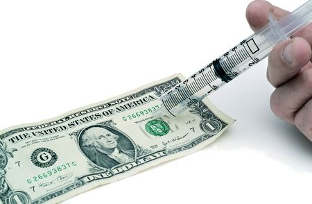 syring: Concept of injecting life into the dollar or economy
