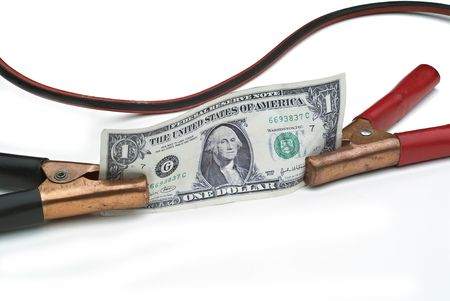 점프 스타트 또는 경제 또는 달러 상승의 개념을 묘사하기 위해 미국 달러에 첨부 된 부스터 케이블 스톡 콘텐츠