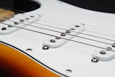 エレクトリック ・ ギターとピックの観点から文字列のクローズ アップ 写真素材