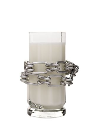 A concept image with a glass of milk with a chain arounding to describe lactose intolerance Stock Photo