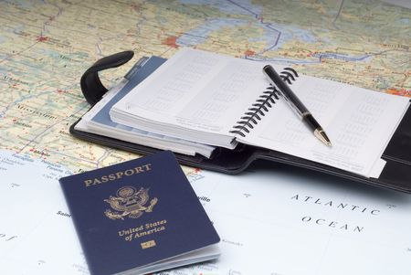 A US Passport and a day planner on a map.Possibly planning a cruise vacation Zdjęcie Seryjne