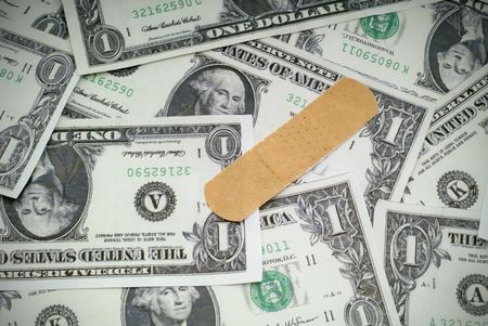 Concept of putting a bandage on the US economy Banco de Imagens