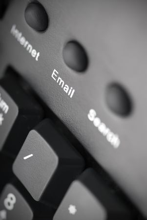 closeup of an email button on a black keyboard Banco de Imagens