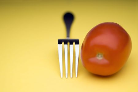snappy: snappy image of a fork and a tomato on a bright yellow background
