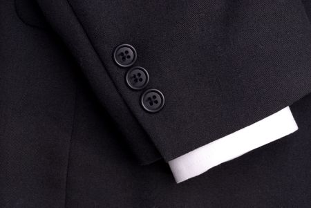 cuff: closeup of a suit sleeve with a white cuff