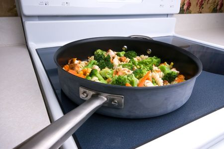 Cooking vegetables on the stovetop Imagens