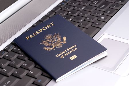 Passport on a notebook to show booking a trip