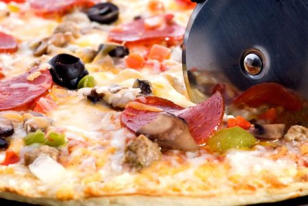cutter: A closeup of freshly cooked pizza Stock Photo