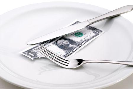 Dinero con una mordedura fuera de it.Representing teniendo una mordedura de la econom�a o el aumento del costo de los alimentos.  Foto de archivo