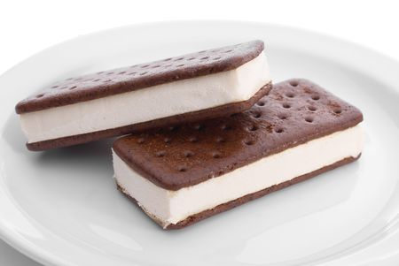 Two tasty frozen icce cream snack sandwich bars on a white plate
