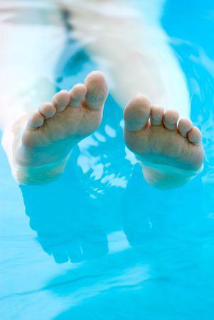 Feet lounging in a pool Reklamní fotografie