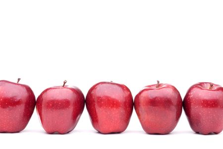 Red apples line up on a white background
