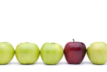 Green apples lined up on a white background with a single different red apple