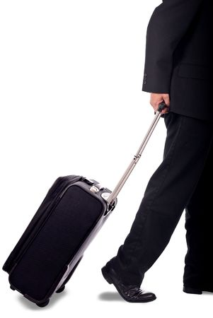 Business man walking with pull-behind luggage