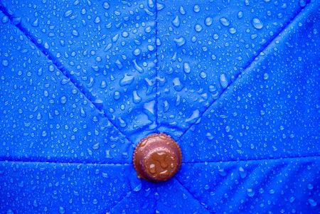 brolly: A closeup of a wet blue unmbrella Stock Photo