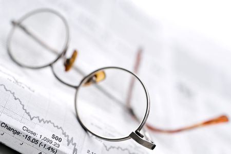 recap: Glasses on a newspaper stock report Stock Photo