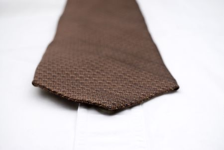 Shallow focus macro of a necktie on a white shirt Stock Photo