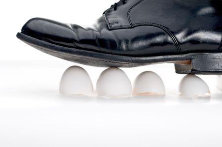 Black business show walking on eggshells Stock Photo