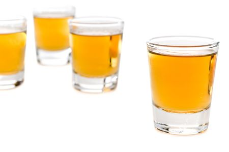 Shot glasses of whiskey