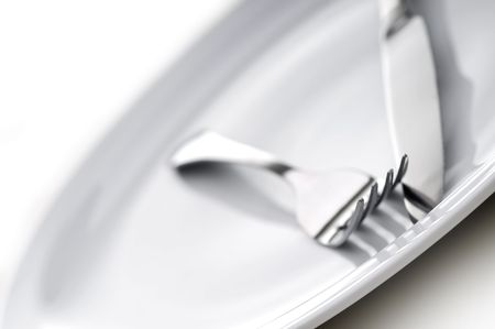 shallow focus silverware on a plate