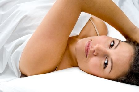 Attractive young woman lounging in bed
