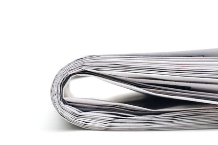 Closeup of the end of a folded newspaper Imagens