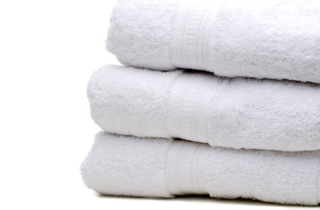 A stack of white towels on white
