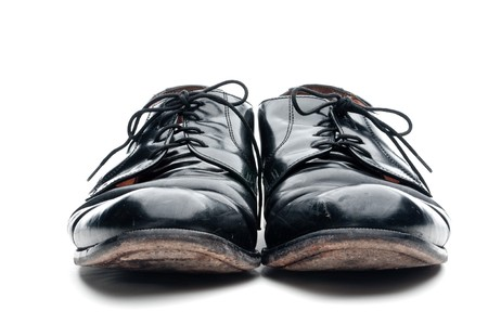 loafer: A pair of old worn black leather business shoes