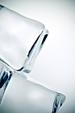 Cross processed tilted extreme close up of ice cubes Stock Photo