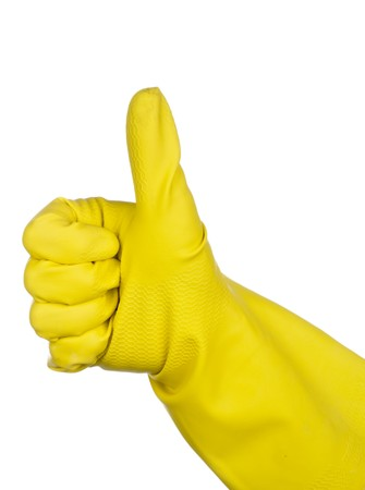 A hand in a yellow rubber glove giving the Thumbs up sign